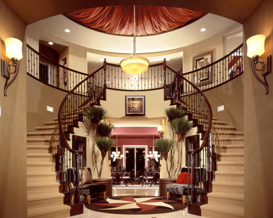 Incredible Foyer With Dual Staircases For An Imposing First Impression