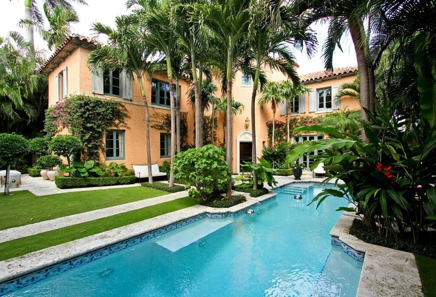 Here is a path with a small lining of palms shading the entrance. This is a great job for palms. Palms often look very organized and can be lined up well to fit along paths or between features.