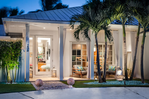 A couple of palm trees outside your window will not block your view but will still give the side of your home some landscaped appeal. The canopy that palm trees provide is both out of the way and visually appealing.
