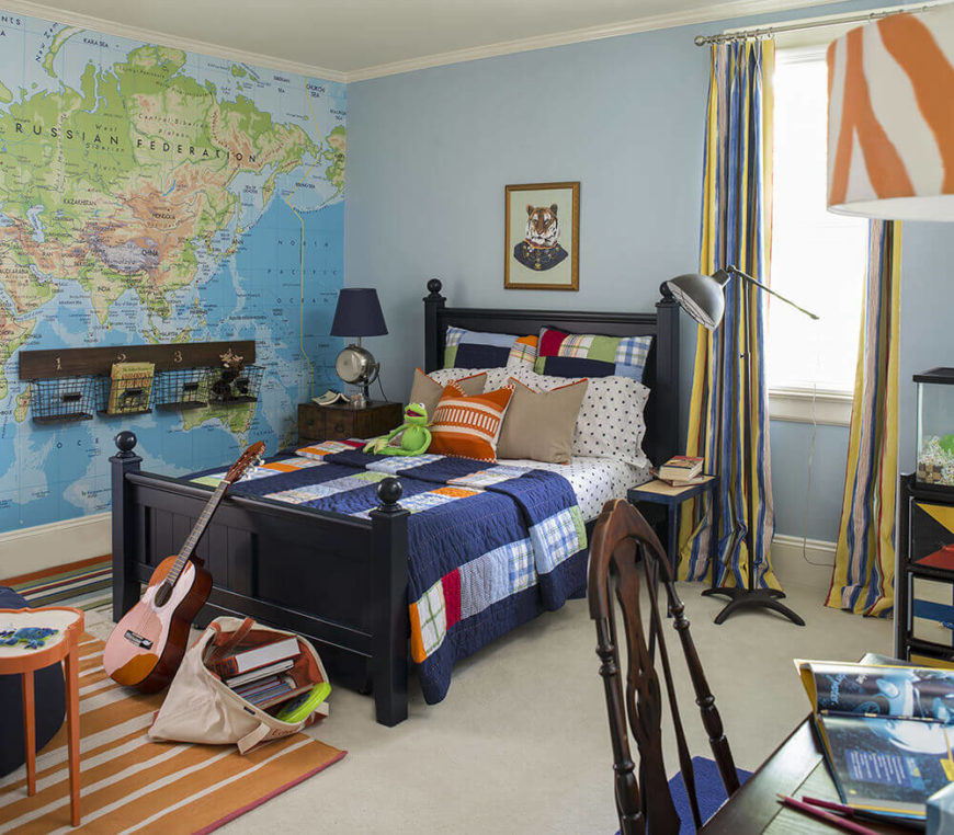 Here's one of the teenage boy bedrooms, absolutely bursting with color and character. One entire wall is a world map, while the furniture all sports multiple colors and patterns.