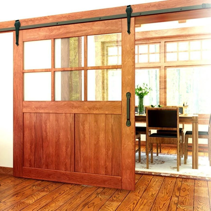 A large wooden barn door the top half ided into window panes. This allows & 30 Sliding Barn Door Designs and Ideas for the Home
