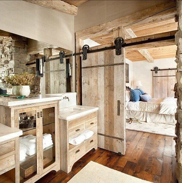This is a perfect example of just how lovely a rustic barn door can look in a distinctly rustic home.