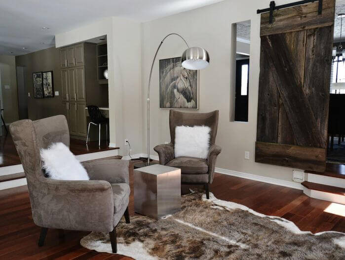 Sliding barn doors can also be used as a gate of sorts, to prevent guests from taking a wrong step down into an attached living room and falling.
