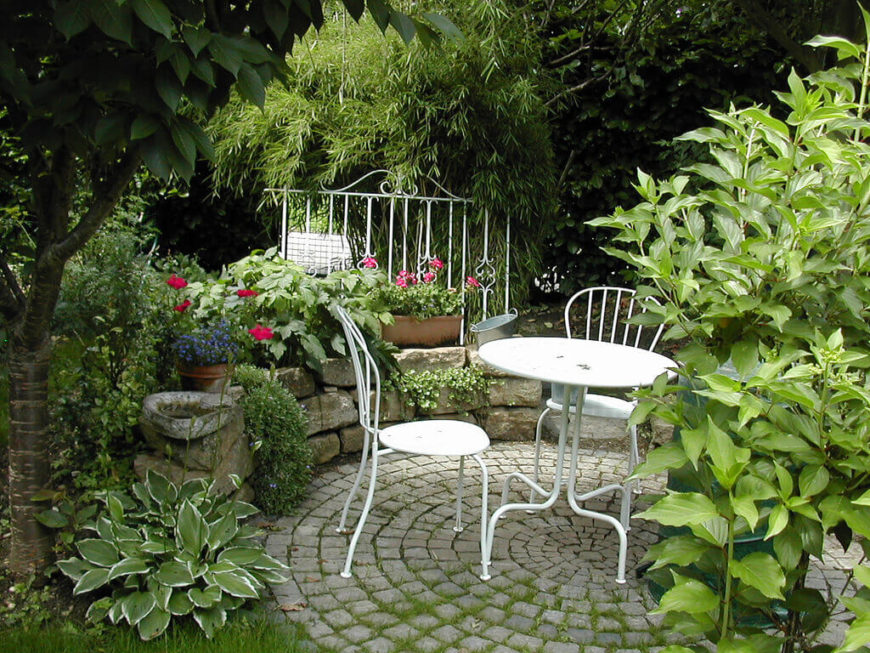 If you are near a natural growth of trees, you can place your small garden near it to incorporate them. This will tie them together, making it look as though the woods were part of a planned garden area.