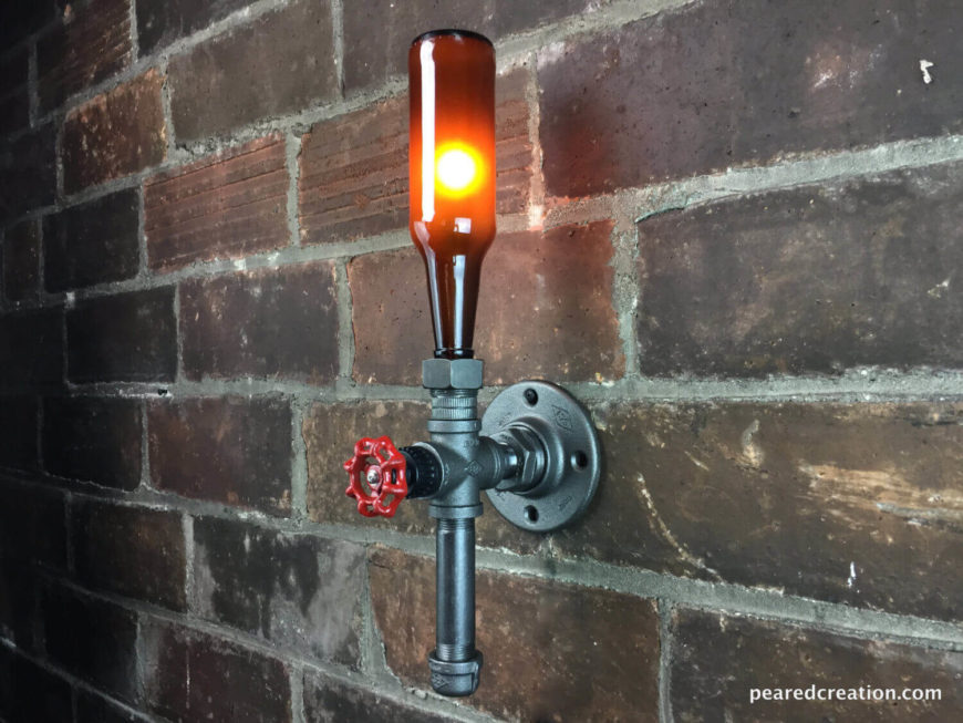 This simple vertical sconce uses pipe and an old beer bottle to create a unique industrial light fixture that will look great in any man cave or bar area. The rotating faucet handle turns the fixture on and off.
