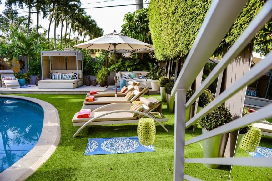 Turf goes great around a pool. You can have the soft feel of astroturf on your feet while you spend your day by the pool. You won't have to worry about overgrowth or moving all of your pool furniture to water or mow either.