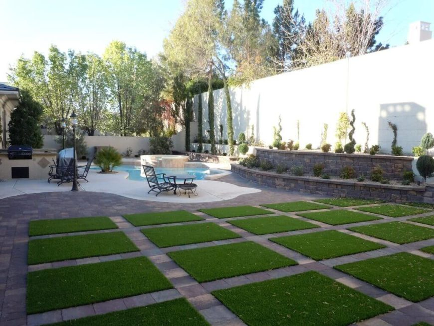 Here is a fantastically creative lawn that uses astroturf. Rather than a continuous patch of astroturf there are a number of individual squares separated by lines of bricks. This creates an interesting pattern that is fun and unique.
