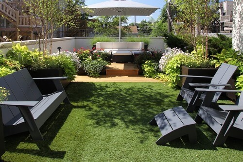 Here is a small yard space with astroturf. When your space is quite small, it may be worth it to lay down turf rather than deal with the maintenance that comes with a natural lawn.