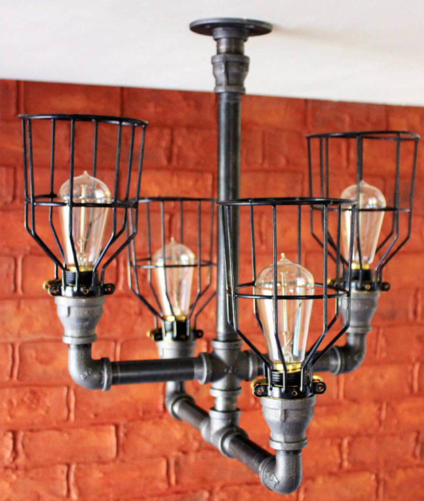 35 industrial lighting ideas for your home this lovely industrial chandelier has four twisted pipes fitted with caged edison light bulbs this arubaitofo Gallery