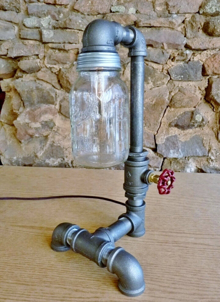 This deluxe mason jar lamp stands 17 inches tall and features a heavy base and a mason jar bulb cover. The faucet handle acts as an on-off switch. Comes with two 25 watt bulbs.