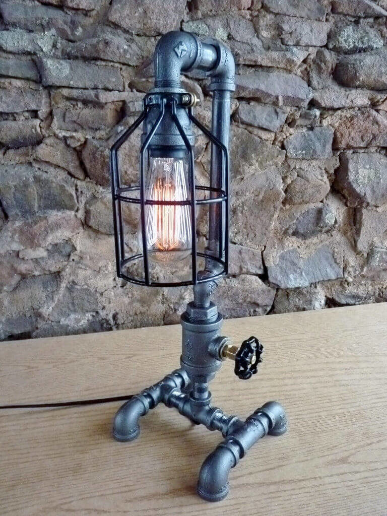 The faucet handle controls the dimmer switch on this lovely table lamp, which features a black cage and an Edison bulb. The listing includes a 60 watt light bulb that is rated at 3,000 hours.