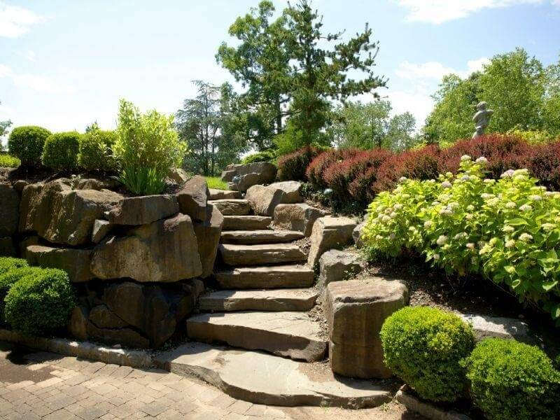The massive stones here are carved to give way to these lovely stone steps. When there are stones this large lining your stairs you have automatic carved rails. These steps are guaranteed to be sturdy and long lasting.