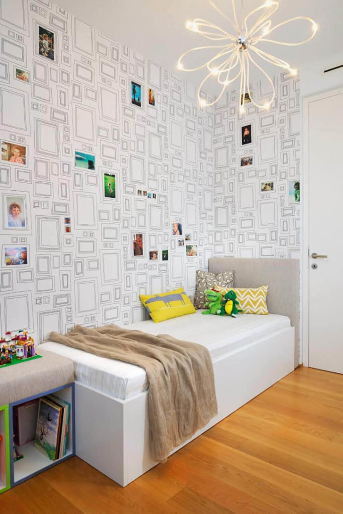 Here is the child's bedroom, a smaller space bursting with color and detail. The specialized wallpaper design plays host to pictures and artwork in a unique way.
