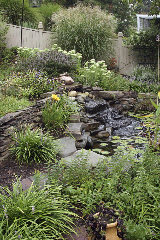 Plumes of tall grass are perfect near water features. This can really help build a natural waterfront look. Natural swamps and streams have lots of tall grasses to draw inspiration from.