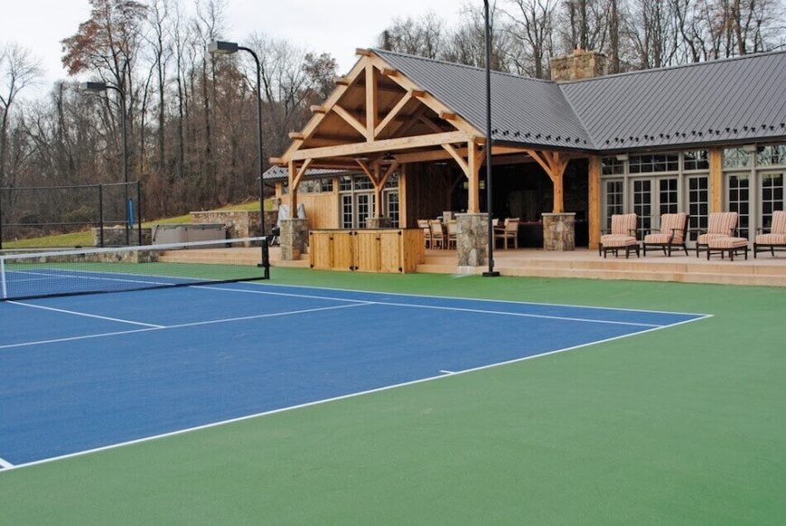 Tennis courts can range in color depending on material. While most courts lean toward green, blue is an interesting choice that not only fits but makes a great impression.