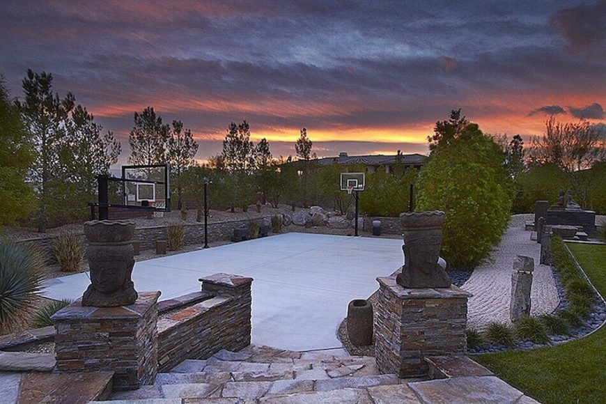 This full sized basketball court is a great space to shoot hoops. It is a simple space with no paint, but it is surrounded by great landscaping and lighting elements.