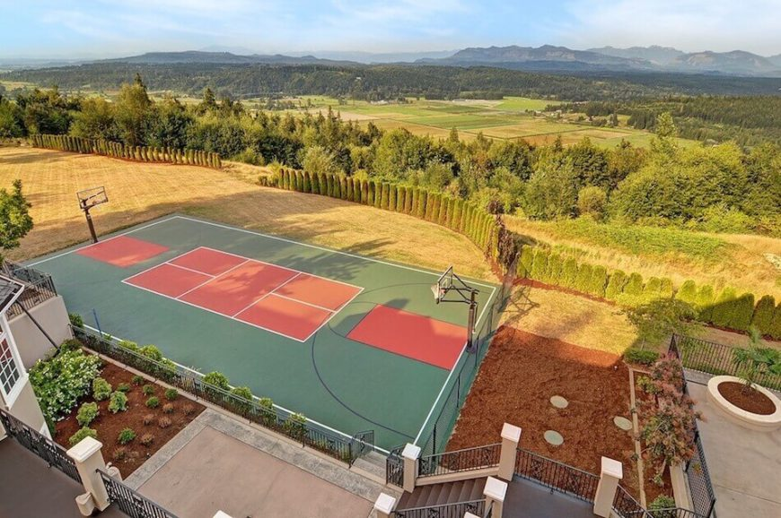 Here is a court with basketball hoops on the long ends of the tennis court. - 34 Backyard Courts For Different Sports (Tennis, Basketball