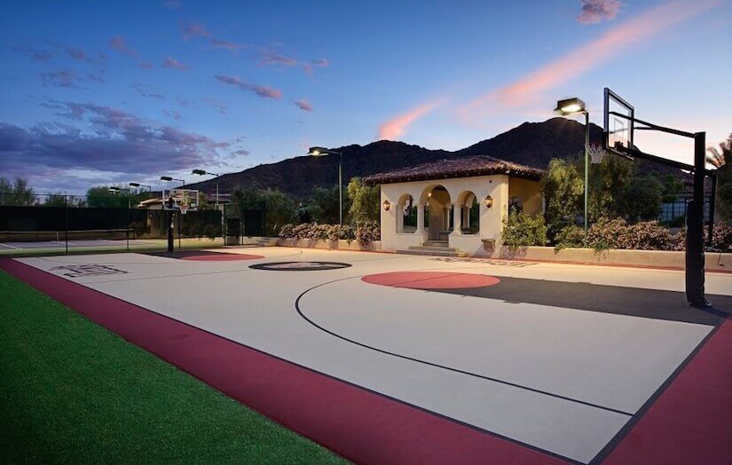 This backyard is adorned with a great full sized basketball court. This  space can be - 34 Backyard Courts For Different Sports (Tennis, Basketball