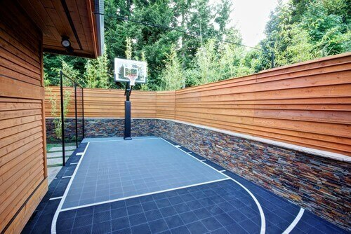 You may be surprised to learn what kinds of spaces can hold a decent basketball court. This space has enough room for you to practice your hook shots and free throws. Don't count out having a basketball court if you have limited space. You never know until you try.