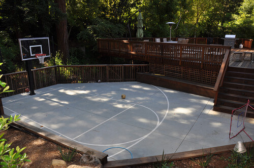 Here is a simple painted half court that sits right off of this deck. This - 34 Backyard Courts For Different Sports (Tennis, Basketball