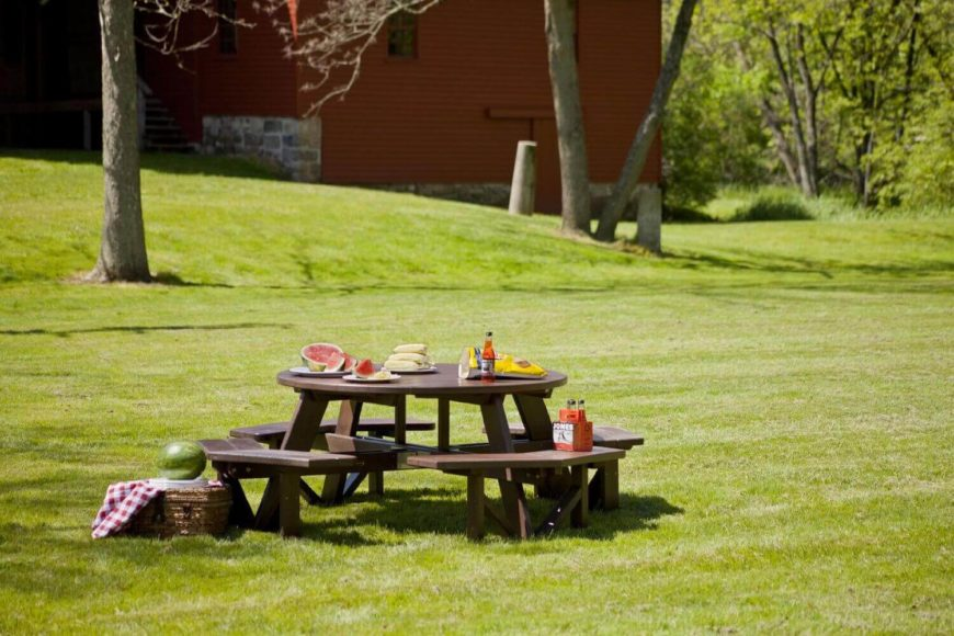 Here is a spectacular high end picnic table. It is a large octagonal design with ample seating and space. This table is constructed out of sturdy and long lasting polywood and is stained to be waterproof.