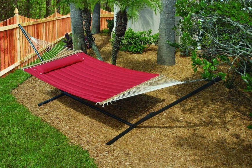 This padded hammock has its own stand. This is useful if you don't have trees that you can hang a hammock between. This hammock even comes with a pillow that can be attached to the end of the mat to make your lounging more comfortable.