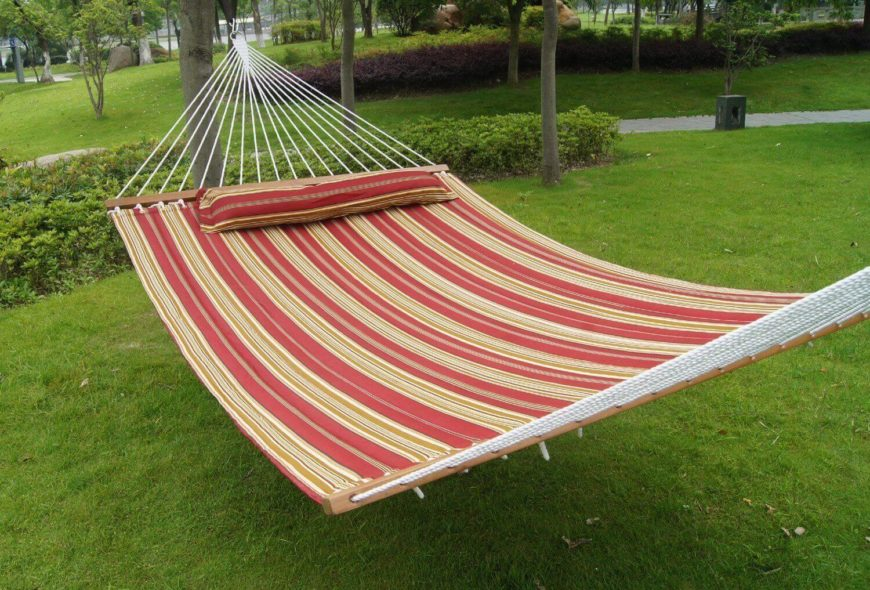 Medium image of between these trees hangs a wonderful cloth hammock with an attached pillow  this hammock is