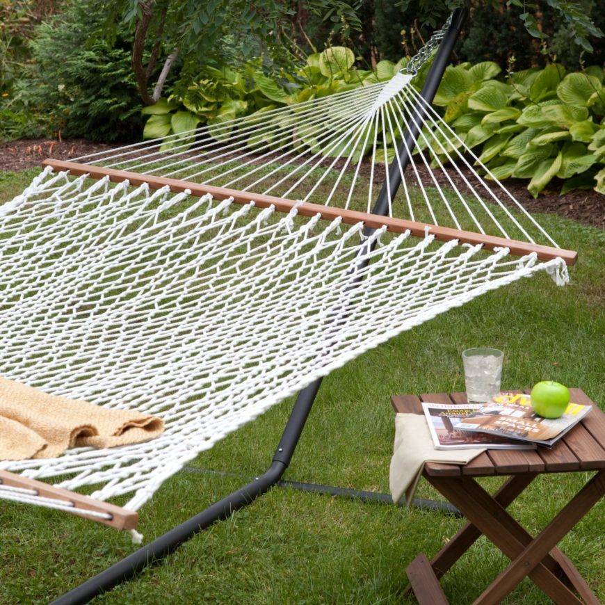 Here is a hammock that is made out of a traditional rope weave. This style is classic and uncomplicated. The wooden beams on either side are quite useful, keeping the hammock tangle free.