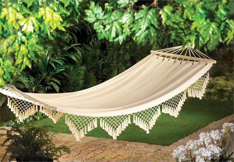 Here is a cloth hammock with a bit of a design flair. The hammock is very simple in design, but the hanging fringe gives it some extra charm that can provide your space with a light, elegant touch.