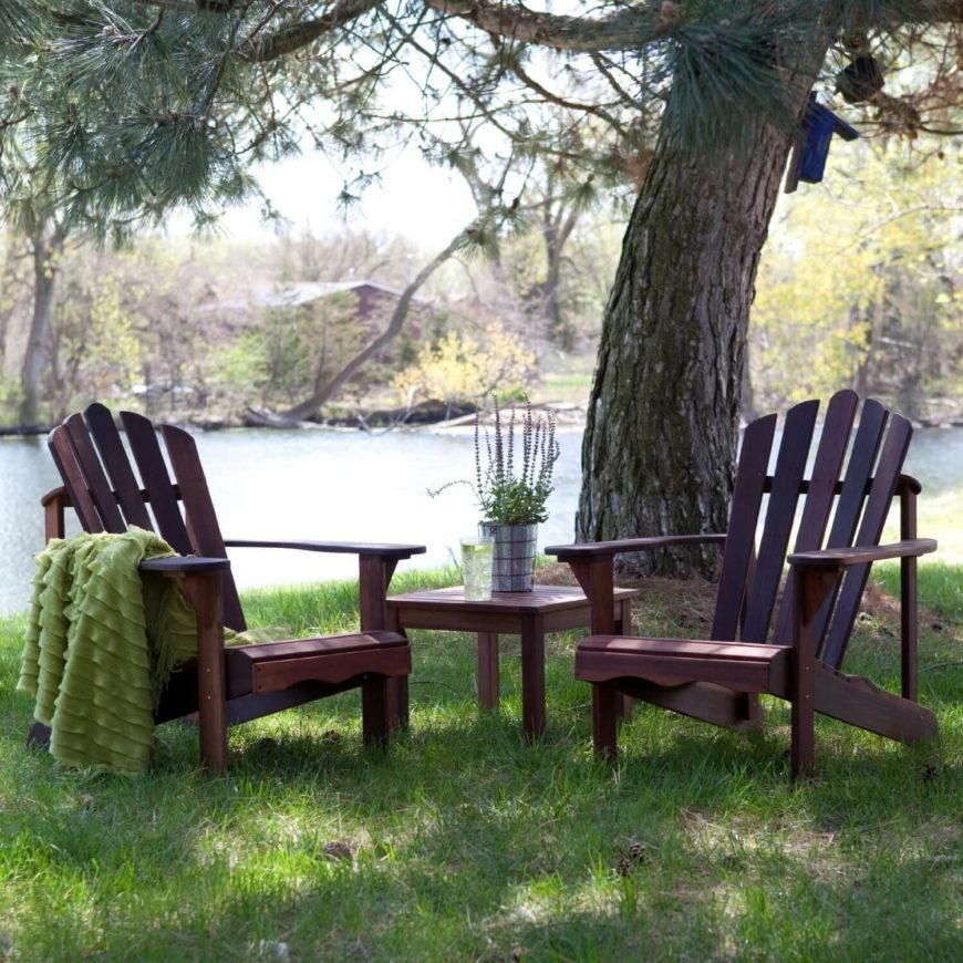 This pair of adirondack chairs sits under a shady oak near a serene lake. This is a great space for such a relaxing piece of furniture. This is the kind of spot where you can take in your surroundings in comfort.