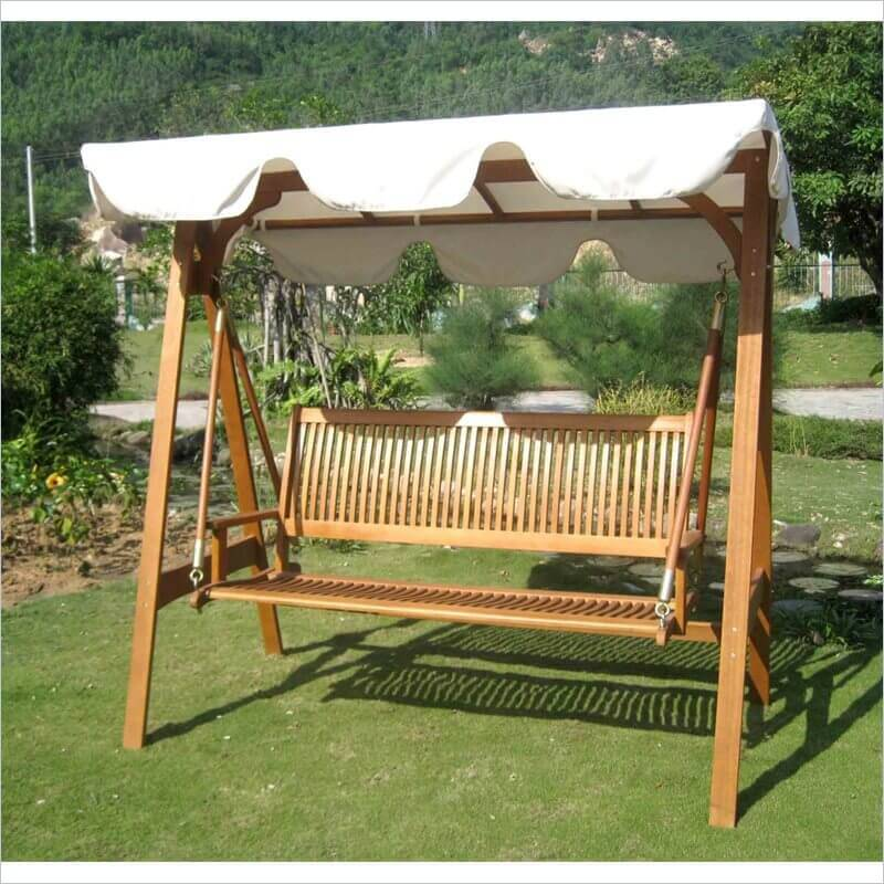 This simple and beautiful yard swing is made from light colored wood and has a white canvas umbrella. This piece is bright and can lighten up any space while providing relaxation and comfort.