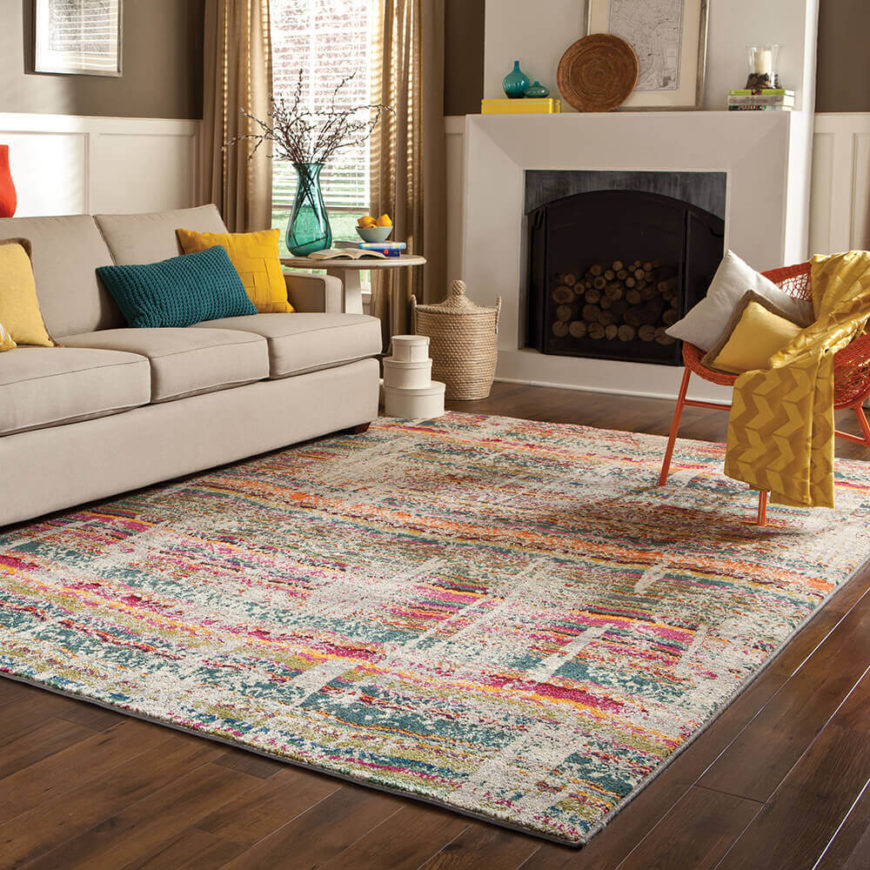 Whimiscal and fun, this rug incorporates colors of pink, teal, and brick red. This show-stopping rug is perfect for a children's play area or to add a bit of trendiness to a family room.