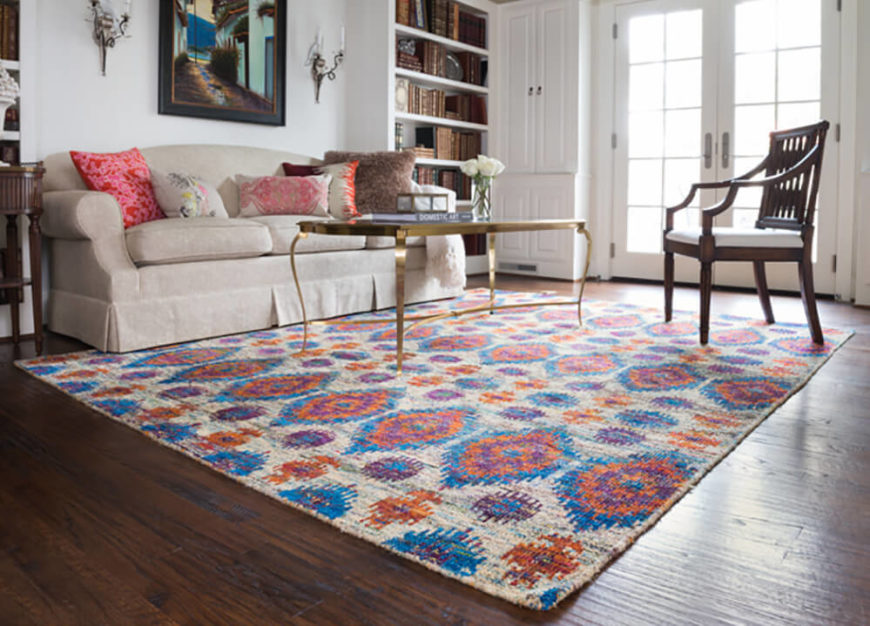 Enchant friends and family with this vibrant rug featuring bright shades like orange, blue, and purple.