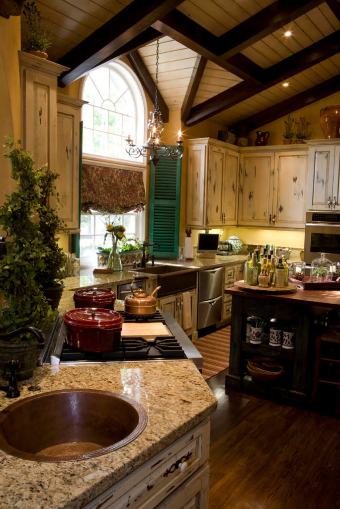 Distressed cabinets and other wooden features brings a degree of rustic patina that has a wonderful and homey appeal.