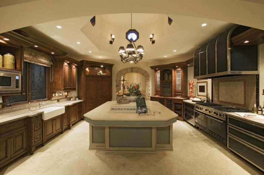 This large open Mediterranean kitchen has a number of fantastic lighting features which illuminate its fantastic colors and designs.