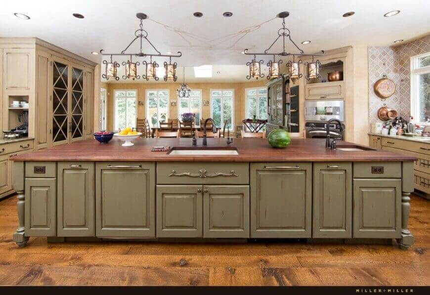 This Open And Spacious Mediterranean Kitchen Has A Very Large Island To  Increase Counter Space And