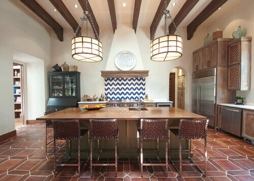 This kitchen uses fabulous terracotta tiles to set a warm and rich backdrop for the rest of the beautiful features.