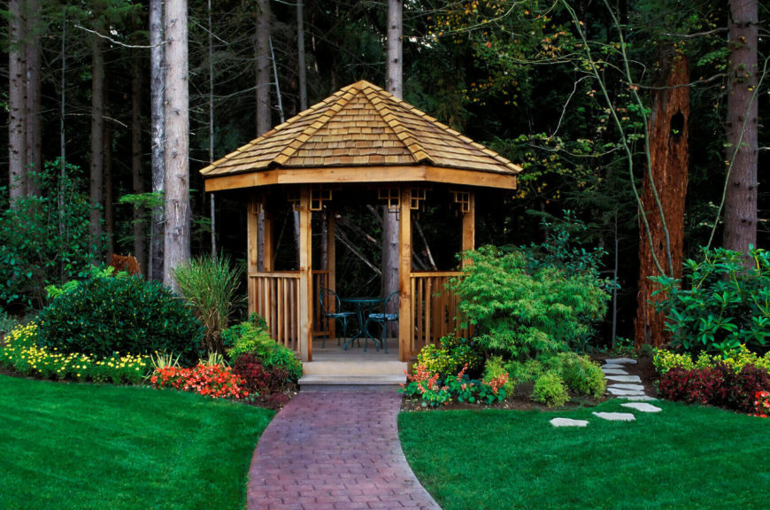 This gazebo serves as a nice passageway into the forest as well as a nice seating area to enjoy the garden and forest.