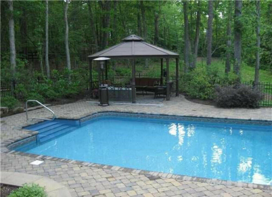 This small gazebo has an included bench, making it perfect for a resting spot on a warm summer day. You can hop out of the pool and relax in the gazebo.