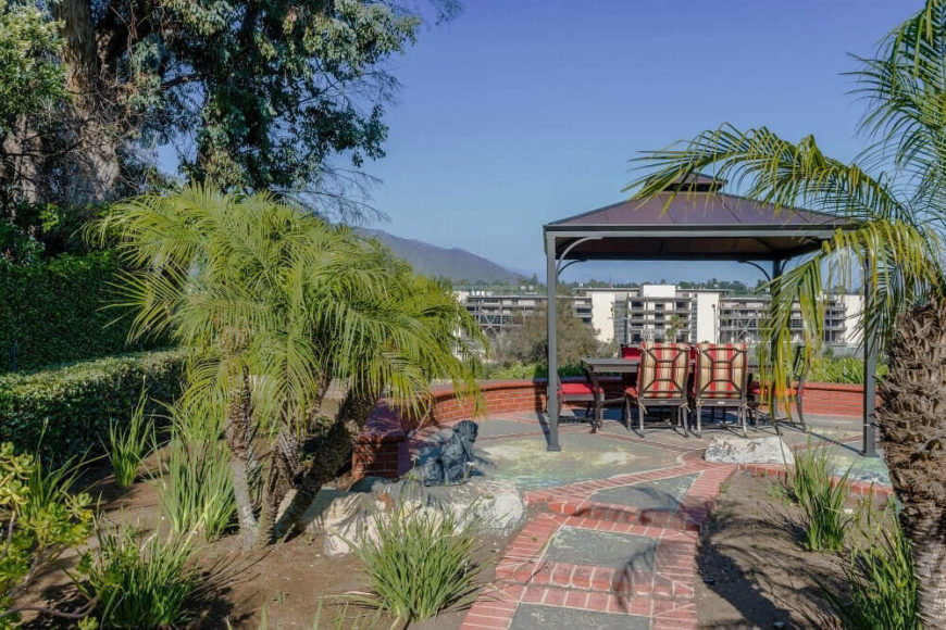 This simple gazebo sits at the end of a patio, overlooking the view on the other side. This is a wonderful shady spot to sit and enjoy the property or the landscape out yonder.