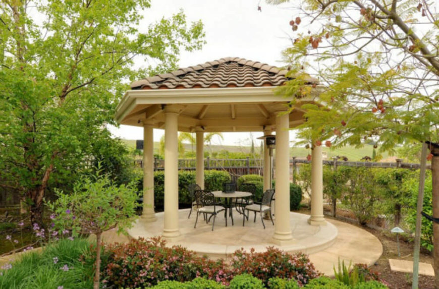 This Gazebo Is Reminiscent Of Old Grecian Architecture With Tall White Pillars A