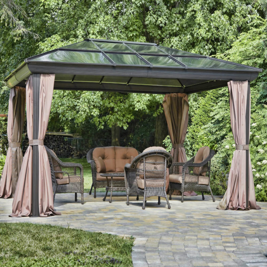 Glass top gazebos are wonderful if you like to gaze up at the sky but want the protection of the roof. These spaces are great for letting your mind wander on a sunny day or for relaxing under the rain watching the drops collect and pour off of the glass roof above you.