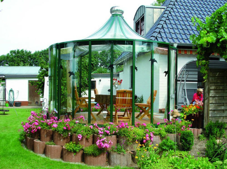 This glass gazebo provides protection from the elements on almost every side, but still allows for a great view.