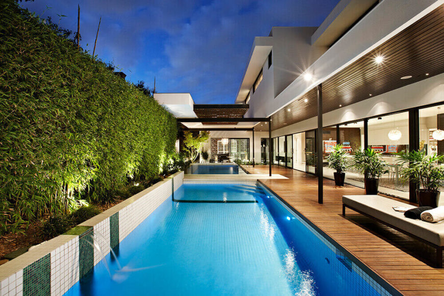 The striking pool design is wrapped by bamboo at left and the house itself on the right. This exquisite design is as sharply considered as the structure itself.