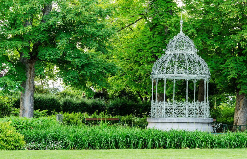 This white gazebo with extensive decoration is the perfect gazebo to pair with a garden. The complex, elegant lines in the gazebo match perfectly with the natural lines of plants, vines, and trees.