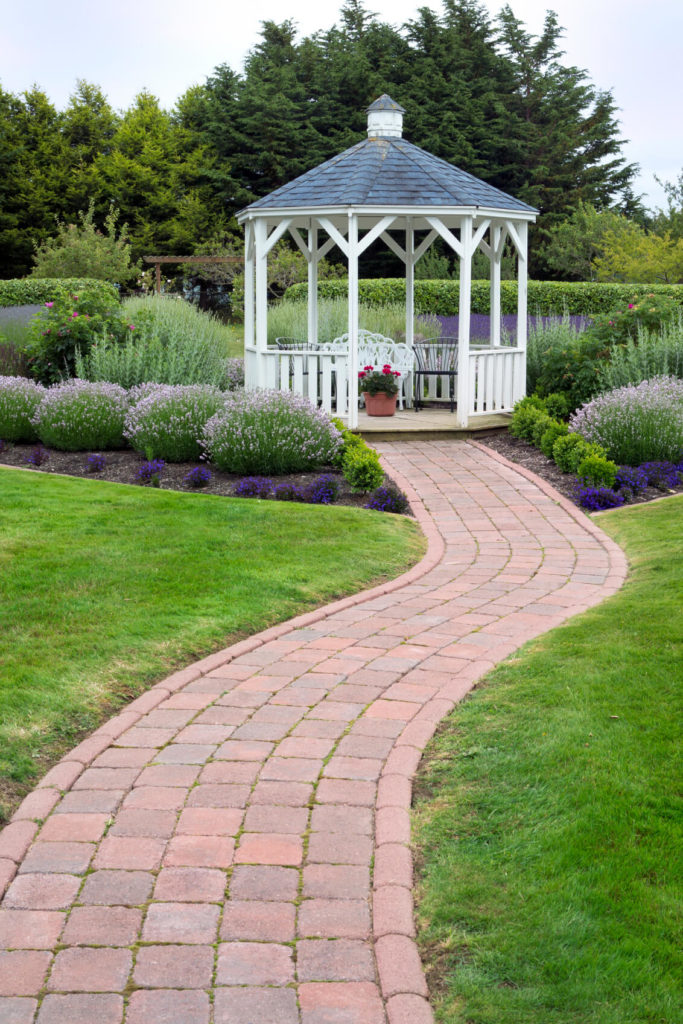 A Neat, Well Organized Garden Is Served Well By A Crisp White Gazebo With  Simple