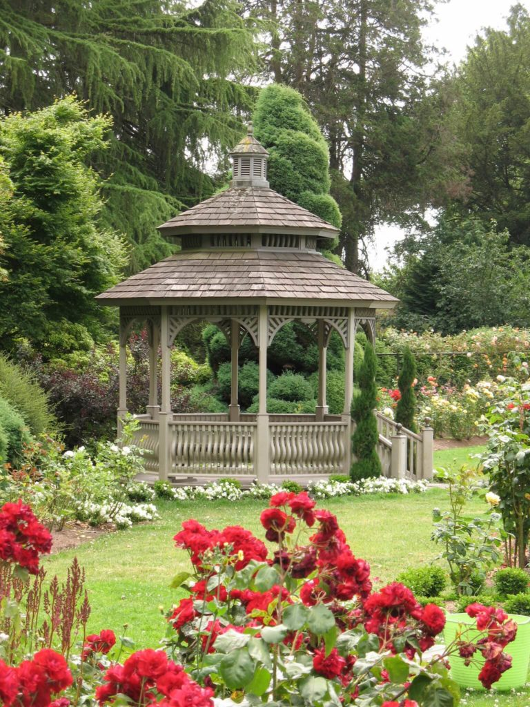 This gazebo serves as a magnificent focal point for this entire garden. This garden sprawls out from the center point, standing in the middle of the space. Gazebos are wonderful structures for central focus.