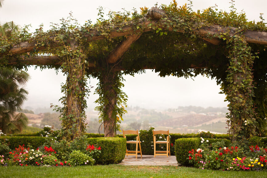 This massive natural wood gazebo is covered in massive vines that give this structure a high level of natural appeal.