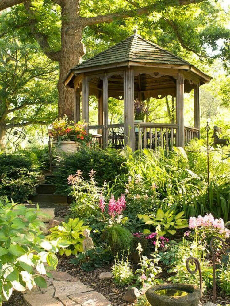 Charming This Simple Gazebo With Natural Wood Finish Is Nearly Swallowed By The  Greenery Around It.