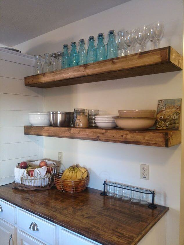 Floating open shelving is a popular look for rustic and farmhouse kitchens, and can be great for storing glassware and other, more attractive kitchen items. The good news is that they're a fairly easy DIY as well!